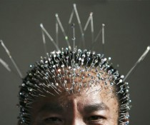 1299749116-wei_shengchu_60_displays_acupuncture_needles_in_hi_2172839354